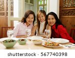 three women sitting at... | Shutterstock . vector #567740398