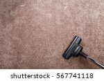 vacuuming carpet with vacuum... | Shutterstock . vector #567741118