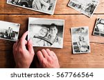 hands holding pictures of... | Shutterstock . vector #567766564