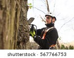lumberjack with chainsaw and... | Shutterstock . vector #567766753