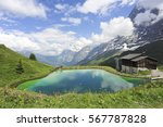 Small photo of Alpine view to the small lake and mountains on background, from Kl. Scheidegg towards the Grindelwald valley, Bern, Joungfrau region, Switzerland