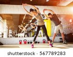 young athletes stretching at... | Shutterstock . vector #567789283