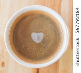 heart in cup of coffee with in... | Shutterstock . vector #567792184