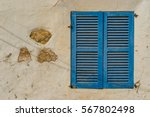 blue wooden window shutters of...   Shutterstock . vector #567802498