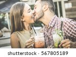 handsome man kissing young...   Shutterstock . vector #567805189