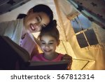 family bedtime. mom and child... | Shutterstock . vector #567812314
