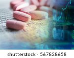 pills scattered on paper with... | Shutterstock . vector #567828658