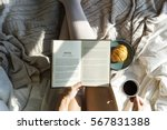 woman reading book novel on bed ... | Shutterstock . vector #567831388