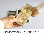 close up 2 hands with stack of... | Shutterstock . vector #567843214