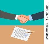 two businessmen shake hands... | Shutterstock .eps vector #567847384