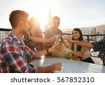 happy young people toasting... | Shutterstock . vector #567852310