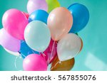 colorful balloons on the mint... | Shutterstock . vector #567855076