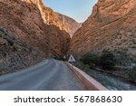 road through deep river canyon  ... | Shutterstock . vector #567868630