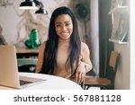 beautiful african woman is... | Shutterstock . vector #567881128