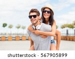 handsome man carring his... | Shutterstock . vector #567905899