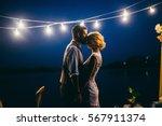 amazing wedding couple near the ... | Shutterstock . vector #567911374