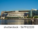 Small photo of Melbourne, Australia - January 6, 2017: view of Etihad Stadium at Docklands, with bollards in the foreground. Etihad Stadium is mainly used to play AFL Australian rules football.