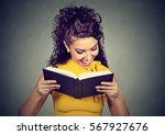 happy young woman reading a... | Shutterstock . vector #567927676