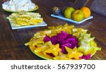 plates of tropical fruits on... | Shutterstock . vector #567939700