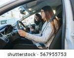 driving instructor teaching  a... | Shutterstock . vector #567955753