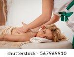 woman enjoying during a back... | Shutterstock . vector #567969910