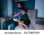 father and son watching scary... | Shutterstock . vector #567989599
