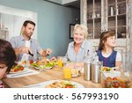 smiling granny while sitting at ... | Shutterstock . vector #567993190