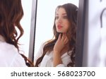 young woman looking herself... | Shutterstock . vector #568023700