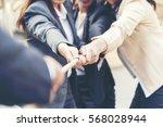 teamwork shake hands... | Shutterstock . vector #568028944