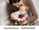 adorable baby with a milk... | Shutterstock . vector #568033408