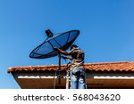 technicians install satellite... | Shutterstock . vector #568043620