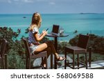 young pretty woman using laptop ... | Shutterstock . vector #568069588