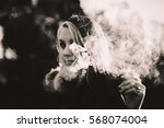 beautiful smoke in the sun... | Shutterstock . vector #568074004
