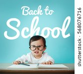 Small photo of Little baby asian girl on blackboard with back to school, Education and preschool concept