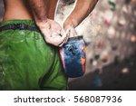 climber man coating his hands... | Shutterstock . vector #568087936