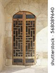 Small photo of Antique carved wooden door, arabesque style, lebanese
