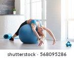 woman in sportswear exercising... | Shutterstock . vector #568095286