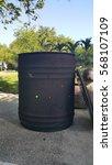 burning trash bin | Shutterstock . vector #568107109