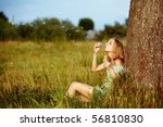 Young Blond Woman Blowing Soap...