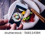 hand's of men taking picture... | Shutterstock . vector #568114384