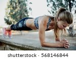 fit girl doing plank exercise...