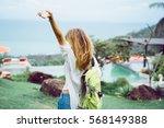 pretty woman posing in the park ... | Shutterstock . vector #568149388