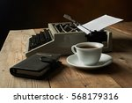 old typewriter on a wooden... | Shutterstock . vector #568179316