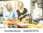 senior couple cooking healthy... | Shutterstock . vector #568187674