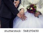 hands of the bride and groom... | Shutterstock . vector #568193650