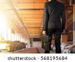 businessman holding a briefcase ... | Shutterstock . vector #568195684