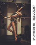 Small photo of Plastic little girl gymnast on acrobatic ring.