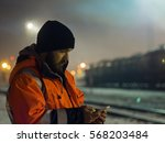 worker using smartphone in the...