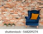 blue armchair with orange...