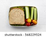 healthy lunch box with sandwich ... | Shutterstock . vector #568229524